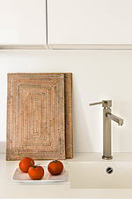 Close up of a mixer faucet and sink in the kitchen of a  modern, residential building - 16696-10-1