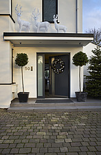 Exterior view of residential building with white and silver Christmas decorations - 16753-250-1
