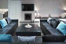 Interior view of residential building, black leather sofa in living area - 16753-40-1