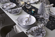 Interior view of residential building, detail of set dining table with Christmas crackers and decorations - 16753-90-1