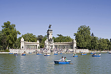 People boating on an artificial lake in front of the monument to Alfonso XII, Buen Retiro Park, Madrid, Spain - 40035-560-1