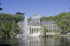 View across the lake to Palacio de Cristal, or Crystal Palace, designed by architect Ricardo Velazquez Bosco (1887), Buen Retiro Park, Madrid, Spain - 40035-670-1