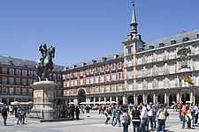 Statue of Philip III (1616) on horseback in a busy Plaza Mayor, Madrid, Spain - 40035-780-1