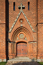 Arched doorway of 19th century red brick neo-gothic style church, Picher, Mecklenburg-West Pomerania, Germany - 40086-350-1