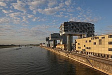 View along River Rhine with crane shaped buildings on old port, Cologne, Germany - 40086-170-1