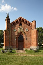 Facade and arched entrance to red brick country church, Mecklenburg-Western Pomerania, Germany - 40086-260-1