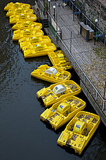 Yellow pedal boats on the river Vlatva, Prague, Czech Republic - 40090-100-1
