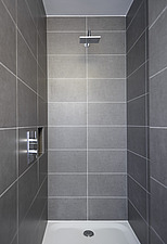 A tiled shower cubicle - 16929-60