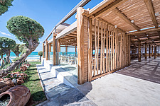 Exterior view of Rinela Restaurant at Mitsis Rinela Beach Resort & Spa in Crete island Greece by Elastic Architects - 16946-10