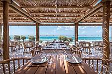 Interior view of dining hall and custom-made furniture, Rinela Restaurant at Mitsis Rinela Beach Resort & Spa in Crete island Greece by Elastic Archit... - 16946-160