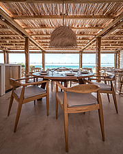 Interior view of dining hall and custom-made furniture, Rinela Restaurant at Mitsis Rinela Beach Resort & Spa in Crete island Greece by Elastic Archit... - 16946-220
