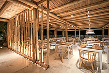 Interior view of entrance and dining hall at night, Rinela Restaurant at Mitsis Rinela Beach Resort & Spa in Crete island Greece by Elastic Architects - 16946-250