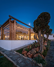 Exterior view at dusk of Rinela Restaurant at Mitsis Rinela Beach Resort & Spa in Crete island Greece by Elastic Architects - 16946-260