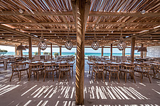 Dining hall and custom-made furniture of Rinela Restaurant at Mitsis Rinela Beach Resort & Spa in Crete island Greece by Elastic Architects - 16946-30