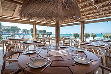 Dining hall and custom-made furniture of Rinela Restaurant at Mitsis Rinela Beach Resort & Spa in Crete island Greece by Elastic Architects - 16946-40