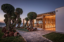 Exterior view at dusk of Rinela Restaurant at Mitsis Rinela Beach Resort & Spa in Crete island Greece by Elastic Architects - 16946-50