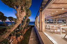 Exterior view at dusk of Rinela Restaurant at Mitsis Rinela Beach Resort & Spa in Crete island Greece by Elastic Architects - 16946-60
