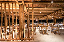 Interior view at night of entrance and dining hall of Rinela Restaurant at Mitsis Rinela Beach Resort & Spa in Crete island Greece by Elastic Architec... - 16946-80