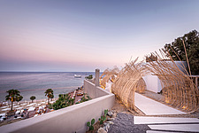 Entrance view and wicker design pergola at sunset of TRU Paradise Beach Club on Mykonos island Greece  - 16948-310
