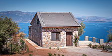 Exterior general view from west overlooking the bay, Mayia Cottage renovation in Aigialeia Hills Peloponnese Greece  - 16953-140