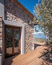 Close up of south-easr facade and terrace deck, Mayia Cottage renovation in Aigialeia Hills Peloponnese Greece  - 16953-250