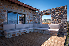 Close up of north-east terrace and built-in lounge, Mayia Cottage renovation in Aigialeia Hills Peloponnese Greece  - 16953-290