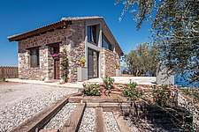 Exterior view of house and landscaping from the south, Mayia Cottage renovation in Aigialeia Hills Peloponnese Greece - 16953-30