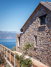 Close up of north-west facade and cliff passage, Mayia Cottage renovation in Aigialeia Hills Peloponnese Greece  - 16953-320