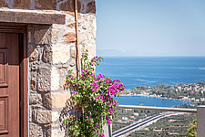 Detail of entrance and bay view, Mayia Cottage renovation in Aigialeia Hills Peloponnese Greece  - 16953-340