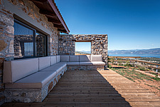 Exterior view of north-east facade and terrace overlooking the bay, Mayia Cottage renovation in Aigialeia Hills Peloponnese Greece  - 16953-60