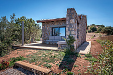 Exterior view of house and terrace from north-east, Mayia Cottage renovation in Aigialeia Hills Peloponnese Greece  - 16953-80