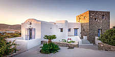 Exterior view of northern facade at sunrise, holiday house in Paros Island Greece by Nikolas Kouretas - ARC100428