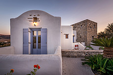 Exterior view of northern facade at sunset, holiday house in Paros Island Greece by Nikolas Kouretas - ARC100429