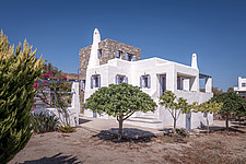 Exterior view of south-west corner, holiday house in Paros Island Greece by Nikolas Kouretas - ARC100431