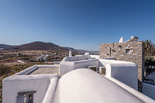 Exterior view of roof terrace overlookong Paros hills and valley, holiday house on Paros Island Greece by Nikolas Kouretas - ARC100442