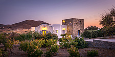 Exterior close up view of northern facade and voneyard at sunset, holiday house on Paros Island Greece by Nikolas Kouretas - ARC100451
