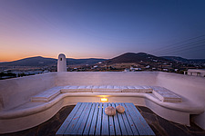 Exterior view of roof terrace lounge at dawn overlookong Paros hills, holiday house on Paros Island Greece by Nikolas Kouretas - ARC100456