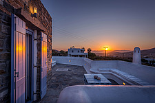 Exterior view of roof terrace and lounge at sunrise, holiday house on Paros Island Greece by Nikolas Kouretas - ARC100457