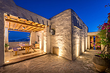 Exterior view of guest house and sequence of entrance terraces at dusk, Villa Elxis in Paros Island Greece by Studio 265 / Vazaios Petropoulos - ARC100820