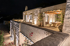Exterior view of upper and lower guest houses and sequence of terraces at night, Villa Elxis in Paros Island Greece by Studio 265 / Vazaios Petropoulo... - ARC100824