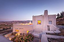 Exterior view of main house from northern side at dusk, Villa Elxis in Paros Island Greece by Studio 265 / Vazaios Petropoulos - ARC100827