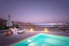 Pool terrace overlooking Naousa Bay and Mycenaean Acropolis sculptured rocks at moon light, Villa Elxis in Paros Island Greece by Studio 265 / Vazaios... - ARC100830