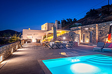 Exterior general view of main house and pool terrace at dusk, Villa Elxis in Paros Island Greece by Studio 265 / Vazaios Petropoulos - ARC100832