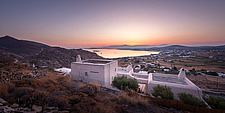 Exterior general context view of complex overlooking Naousa Bay and Mycenaean Acropolis sculptural rocks at dawn, Villa Elxis in Paros Island Greece b... - ARC100834