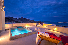 Master bedroom terrace overlooking Naousa Bay and Mycenaean Acropolis sculptured rocks at dusk, Villa Elxis in Paros Island Greece by Studio 265 / Vaz... - ARC100848