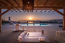 Pool terrace and pergola lounge overlooking Naousa Bay at sunrise, Villa Elxis in Paros Island Greece by Studio 265 / Vazaios Petropoulos - ARC100861