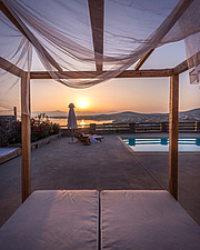 Pool terrace and pergola lounge overlooking Naousa Bay at sunrise, Villa Elxis in Paros Island Greece by Studio 265 / Vazaios Petropoulos - ARC100862