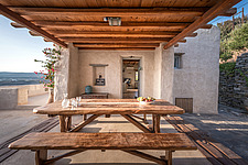 Nexus semi-open space with monastic dining connecting main with guest house and west with east terrances, Villa Elxis in Paros Island Greece by Studio... - ARC100882