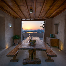 View from nexus semi-open space with monastic dining overlooking Naousa Bay at sunrise, Villa Elxis in Paros Island Greece by Studio 265 / Vazaios Pet... - ARC100897