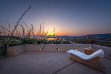 Exterior view from main house terrace overlooking Naousa Bay at sunrise, Villa Elxis in Paros Island Greece by Studio 265 / Vazaios Petropoulos - ARC100898